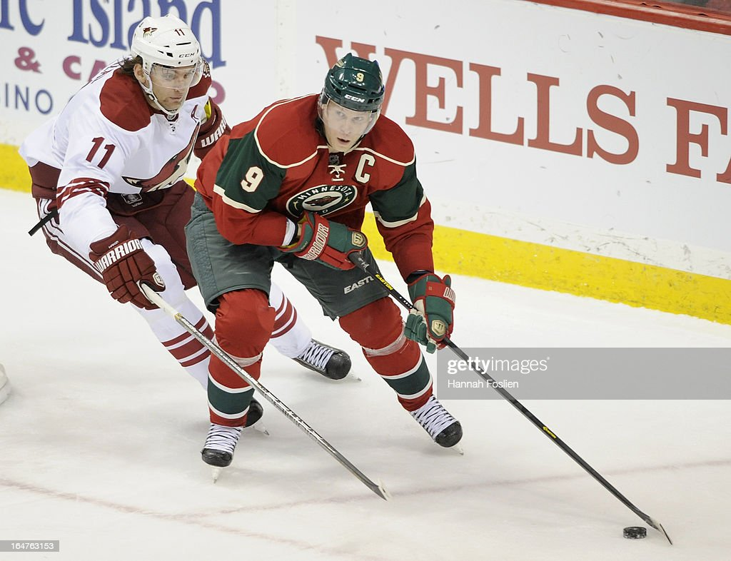 <a gi-track='captionPersonalityLinkClicked' href=/galleries/search?phrase=Mikko+Koivu&family=editorial&specificpeople=584987 ng-click='$event.stopPropagation()'>Mikko Koivu</a> #9 of the Minnesota Wild controls the puck against <a gi-track='captionPersonalityLinkClicked' href=/galleries/search?phrase=Martin+Hanzal&family=editorial&specificpeople=2109469 ng-click='$event.stopPropagation()'>Martin Hanzal</a> #11 of the Phoenix Coyotes during the third period of the game on March 27, 2013 at Xcel Energy Center in St Paul, Minnesota. The Wild defeated the Coyotes 4-3 in overtime.