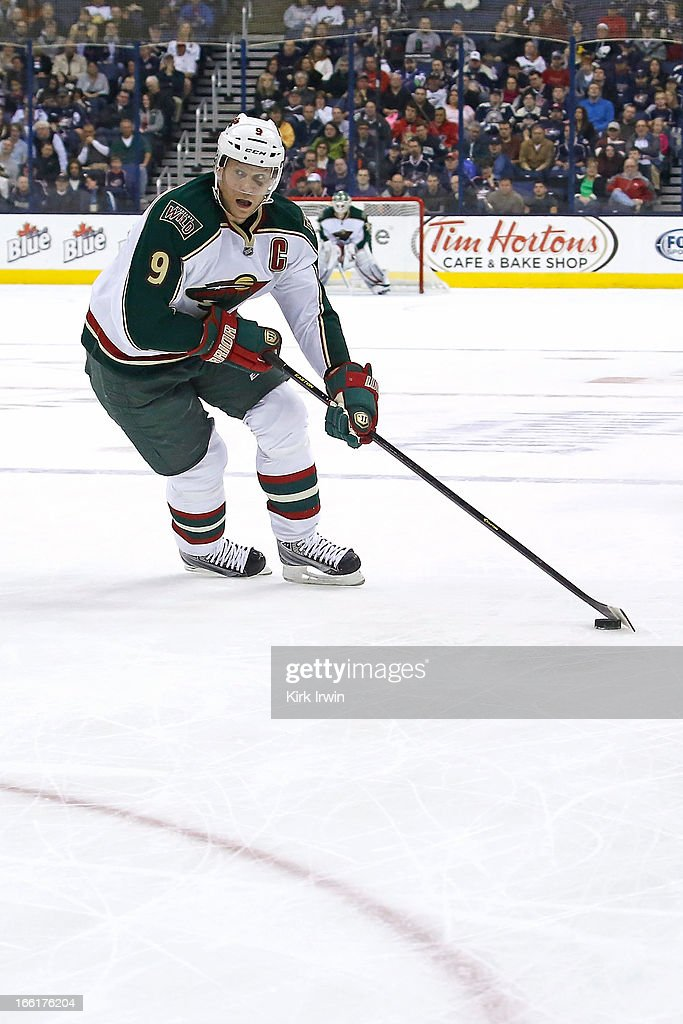Mikko Koivu #9 of the Minnesota Wild controls the puck during the game against the Columbus Blue Jackets on April 7, 2013 at Nationwide Arena in Columbus, Ohio.