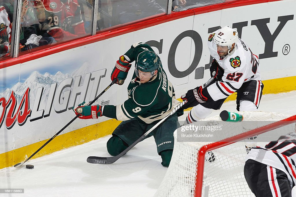 Mikko Koivu #9 of the Minnesota Wild controls the puck from his knees while Johnny Oduya #27 of the Chicago Blackhawks defends in Game Three of the Western Conference Quarterfinals during the 2013 NHL Stanley Cup Playoffs on May 5, 2013 at the Xcel Energy Center in St. Paul, Minnesota.
