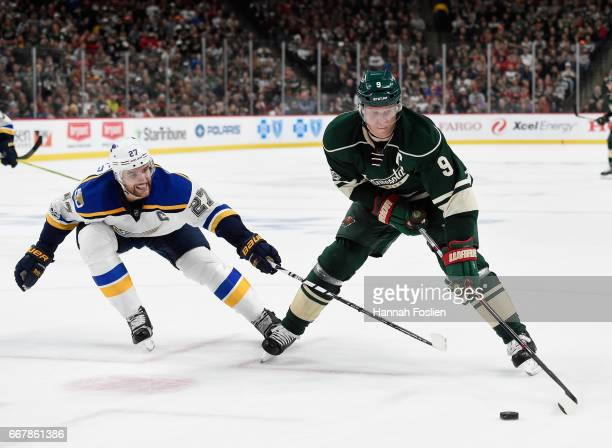 Mikko Koivu of the Minnesota Wild controls the puck shorthanded against Alex Pietrangelo of the St Louis Blues during the second period in Game One...