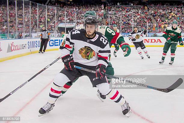 Mikko Koivu of the Minnesota Wild defends Phillip Danault of the Chicago Blackhawks during the 2016 Coors Light NHL Stadium Series on February 21...