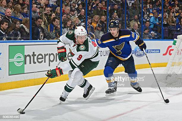 Mikko Koivu of the Minnesota Wild handles the puck as Kevin Shattenkirk of the St Louis Blues defends on December 31 2015 at Scottrade Center in St...