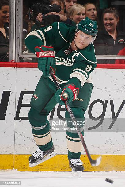 Mikko Koivu of the Minnesota Wild passes the puck against the Arizona Coyotes during the game on January 17 2015 at the Xcel Energy Center in St Paul...