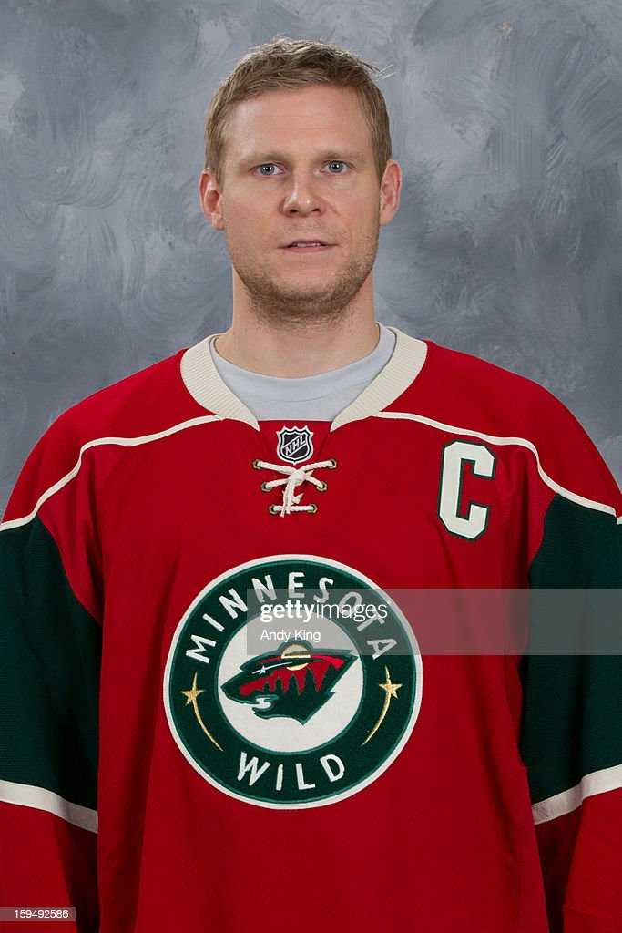 Mikko Koivu #9 of the Minnesota Wild poses for his official headshot for the 2012-2013 season at the Xcel Energy Center on January 12, 2013 in Saint Paul, Minnesota.