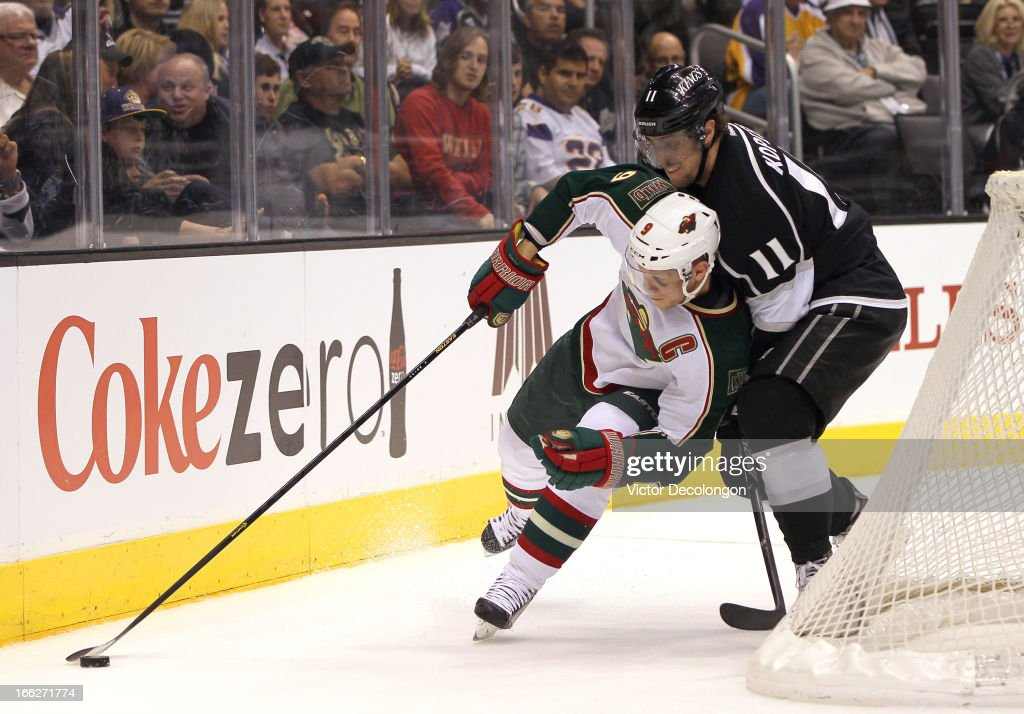 <a gi-track='captionPersonalityLinkClicked' href=/galleries/search?phrase=Mikko+Koivu&family=editorial&specificpeople=584987 ng-click='$event.stopPropagation()'>Mikko Koivu</a> #9 of the Minnesota Wild protects the puck from <a gi-track='captionPersonalityLinkClicked' href=/galleries/search?phrase=Anze+Kopitar&family=editorial&specificpeople=634911 ng-click='$event.stopPropagation()'>Anze Kopitar</a> #11 of the Los Angeles Kings during their NHL game at Staples Center on April 4, 2013 in Los Angeles, California. The Kings defeated the Wild 3-0.