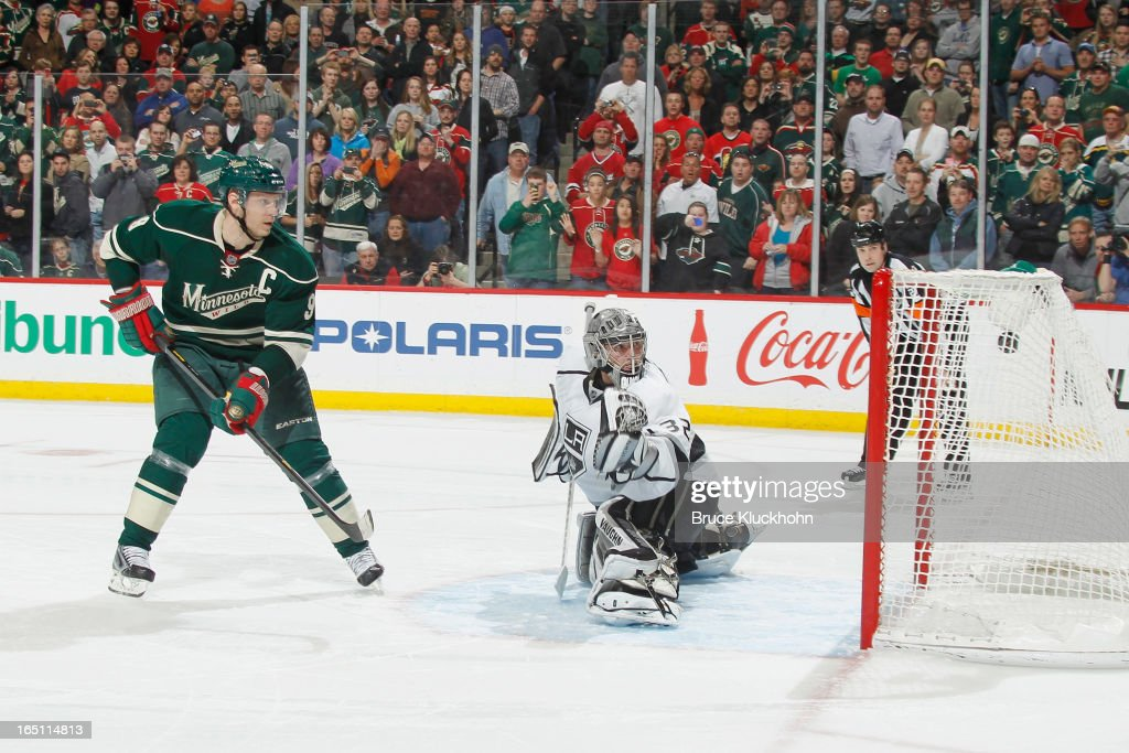 <a gi-track='captionPersonalityLinkClicked' href=/galleries/search?phrase=Mikko+Koivu&family=editorial&specificpeople=584987 ng-click='$event.stopPropagation()'>Mikko Koivu</a> #9 of the Minnesota Wild scores a shootout goal against <a gi-track='captionPersonalityLinkClicked' href=/galleries/search?phrase=Jonathan+Quick&family=editorial&specificpeople=2271852 ng-click='$event.stopPropagation()'>Jonathan Quick</a> #32 of the Los Angeles Kings during the game on March 30, 2013 at the Xcel Energy Center in Saint Paul, Minnesota.