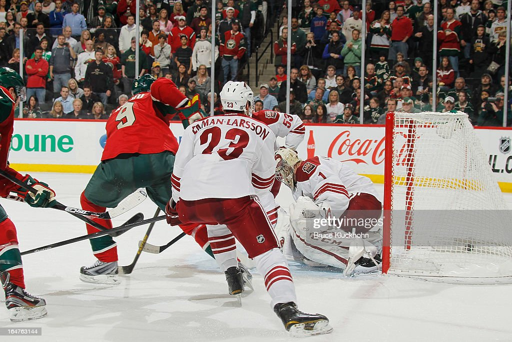 <a gi-track='captionPersonalityLinkClicked' href=/galleries/search?phrase=Mikko+Koivu&family=editorial&specificpeople=584987 ng-click='$event.stopPropagation()'>Mikko Koivu</a> #9 of the Minnesota Wild scores the game winning goal in overtime with <a gi-track='captionPersonalityLinkClicked' href=/galleries/search?phrase=Oliver+Ekman-Larsson&family=editorial&specificpeople=5894618 ng-click='$event.stopPropagation()'>Oliver Ekman-Larsson</a> #23 and goalie <a gi-track='captionPersonalityLinkClicked' href=/galleries/search?phrase=Jason+LaBarbera&family=editorial&specificpeople=240674 ng-click='$event.stopPropagation()'>Jason LaBarbera</a> #1 of the Phoenix Coyotes defending on March 27, 2013 at the Xcel Energy Center in Saint Paul, Minnesota.