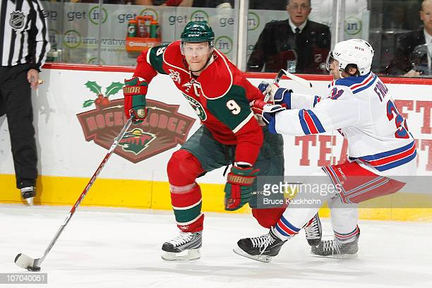 Mikko Koivu of the Minnesota Wild skates against Alexander Frolov of the New York Rangers during the game at the Xcel Energy Center on November 20...
