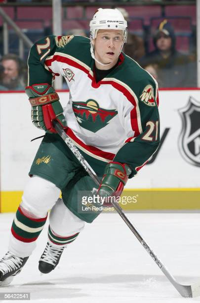 Mikko Koivu of the Minnesota Wild skates against the New Jersey Devils during their NHL game at Continental Airlines Arena on December 3 2005 in East...
