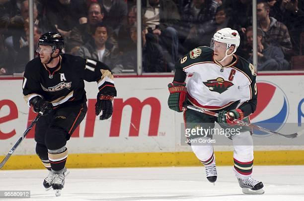 Mikko Koivu of the Minnesota Wild skates on the ice against Saku Koivu of the Anaheim Ducks during the game on December 29 2009 at Honda Center in...