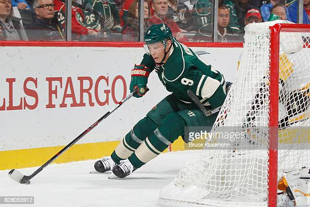 Mikko Koivu of the Minnesota Wild skates with the puck against the Pittsburgh Penguins during the game on November 25 2016 at the Xcel Energy Center...