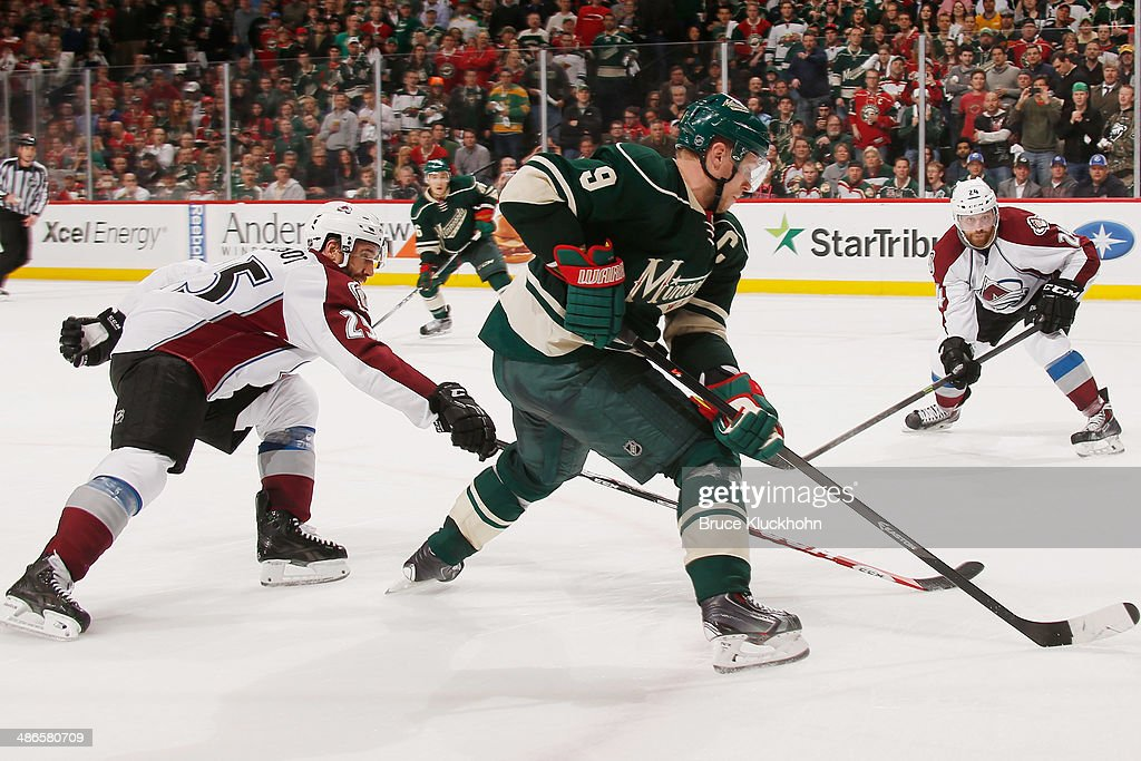 <a gi-track='captionPersonalityLinkClicked' href=/galleries/search?phrase=Mikko+Koivu&family=editorial&specificpeople=584987 ng-click='$event.stopPropagation()'>Mikko Koivu</a> #9 of the Minnesota Wild skates with the puck while <a gi-track='captionPersonalityLinkClicked' href=/galleries/search?phrase=Maxime+Talbot&family=editorial&specificpeople=2078922 ng-click='$event.stopPropagation()'>Maxime Talbot</a> #25 of the Colorado Avalanche defends during Game Four of the First Round of the 2014 Stanley Cup Playoffs on April 24, 2014 at the Xcel Energy Center in St. Paul, Minnesota.