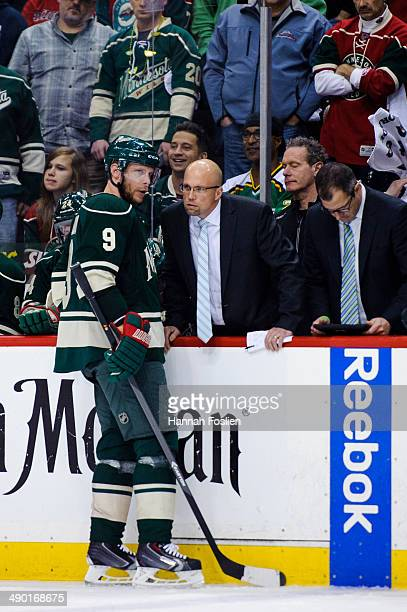 Mikko Koivu of the Minnesota Wild speaks with head coach Mike Yeo in Game Four of the Second Round of the 2014 NHL Stanley Cup Playoffs against the...