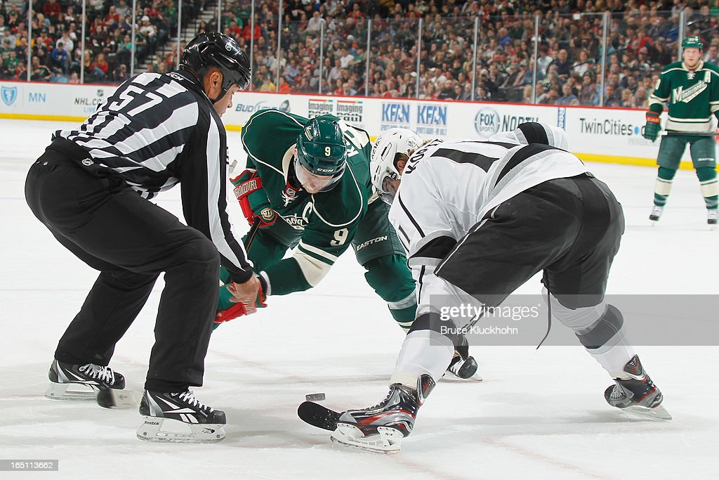<a gi-track='captionPersonalityLinkClicked' href=/galleries/search?phrase=Mikko+Koivu&family=editorial&specificpeople=584987 ng-click='$event.stopPropagation()'>Mikko Koivu</a> #9 of the Minnesota Wild take a faceoff against <a gi-track='captionPersonalityLinkClicked' href=/galleries/search?phrase=Anze+Kopitar&family=editorial&specificpeople=634911 ng-click='$event.stopPropagation()'>Anze Kopitar</a> #11 of the Los Angeles Kings during the game on March 30, 2013 at the Xcel Energy Center in Saint Paul, Minnesota.