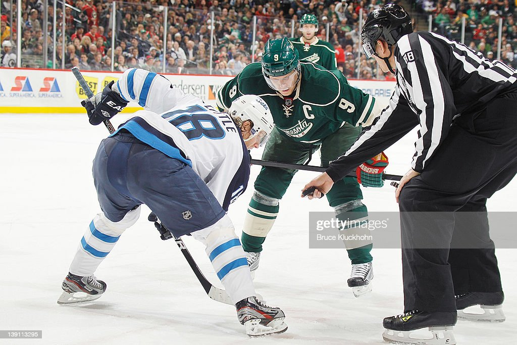 <a gi-track='captionPersonalityLinkClicked' href=/galleries/search?phrase=Mikko+Koivu&family=editorial&specificpeople=584987 ng-click='$event.stopPropagation()'>Mikko Koivu</a> #9 of the Minnesota Wild takes a faceoff against <a gi-track='captionPersonalityLinkClicked' href=/galleries/search?phrase=Bryan+Little&family=editorial&specificpeople=540533 ng-click='$event.stopPropagation()'>Bryan Little</a> #18 of the Winnipeg Jets during the game at the Xcel Energy Center on February 16, 2012 in St. Paul, Minnesota.