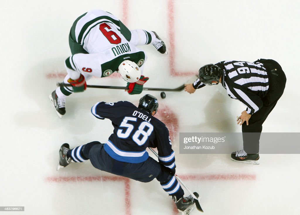 <a gi-track='captionPersonalityLinkClicked' href=/galleries/search?phrase=Mikko+Koivu&family=editorial&specificpeople=584987 ng-click='$event.stopPropagation()'>Mikko Koivu</a> #9 of the Minnesota Wild takes a second-period faceoff against Eric O'Dell #58 of the Winnipeg Jets at the MTS Centre on April 7, 2014 in Winnipeg, Manitoba, Canada.