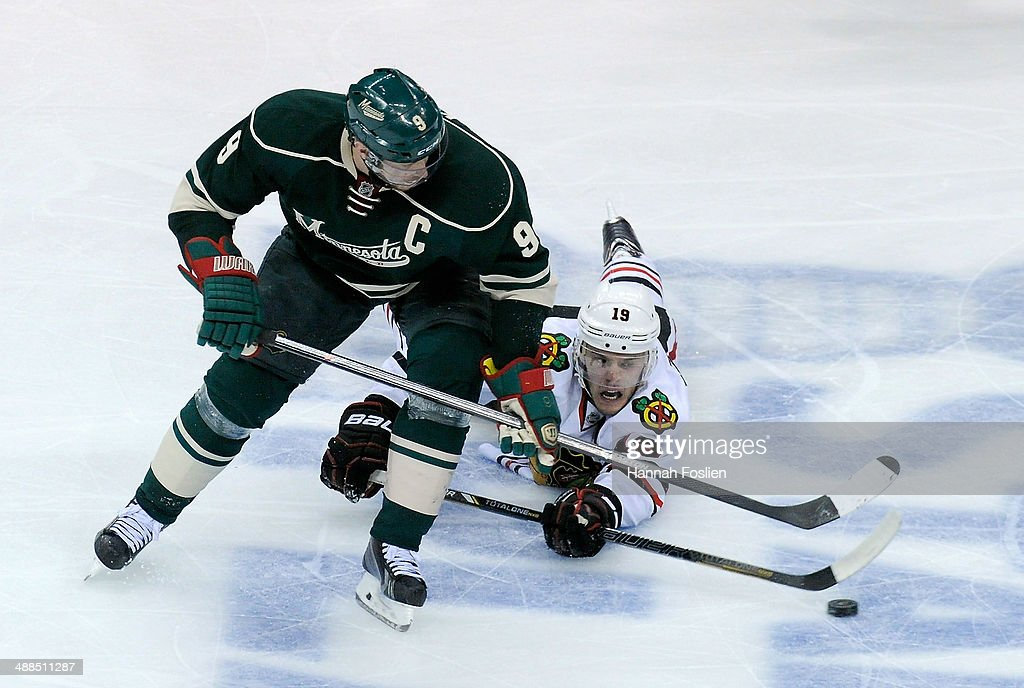 Mikko Koivu #9 of the Minnesota Wild takes control of the puck from Jonathan Toews #19 of the Chicago Blackhawks during the third period in Game Three of the Second Round of the 2014 NHL Stanley Cup Playoffs on May 6, 2014 at Xcel Energy Center in St Paul, Minnesota. The Wild defeated the Blackhawks 4-0.