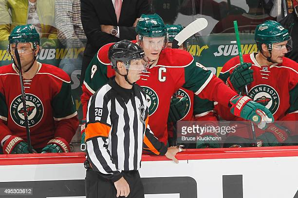 Mikko Koivu of the Minnesota Wild talks with referee Chris Lee during the game against the Columbus Blue Jackets on October 22 2015 at the Xcel...