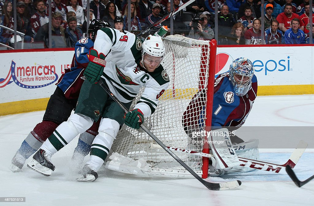 Mikko Koivu #9 of the Minnesota Wild wraps arouns the net with the puck againt Andre Benoit #61 of the Colorado Avalanche as goalie Semyon Varlamov #1 of the Colorado Avalanche defends the goal in Game Seven of the First Round of the 2014 NHL Stanley Cup Playoffs at Pepsi Center on April 30, 2014 in Denver, Colorado.
