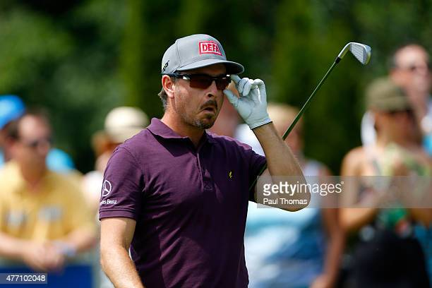 Mikko Korhonen of Finland adjusts his sunglasses as he walks down the 1st fairway during the Lyoness Open day four at the Diamond Country Club on...