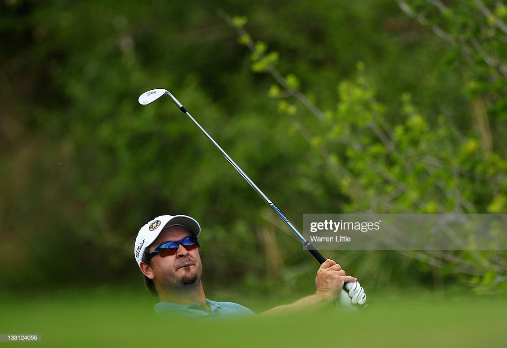 Mikko Korhonen of Finland chips onto the 17th green during the first round of the Alfred Dunhill Championships at Leopard Creek Golf Club on November 17, 2011 in Malelane, South Africa.