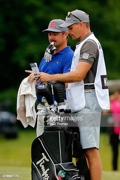 Mikko Korhonen of Finland discusses a shot with his caddie during the Lyoness Open day three at the Diamond Country Club on June 13 2015 in...