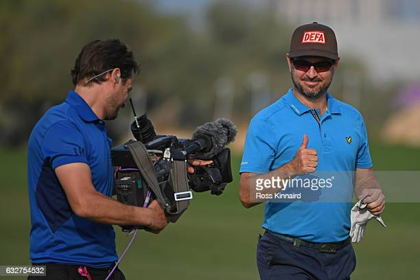 Mikko Korhonen of Finland gives a thumbs up to a camera on the ninth hole during the first round of the Commercial Bank Qatar Masters at the Doha...
