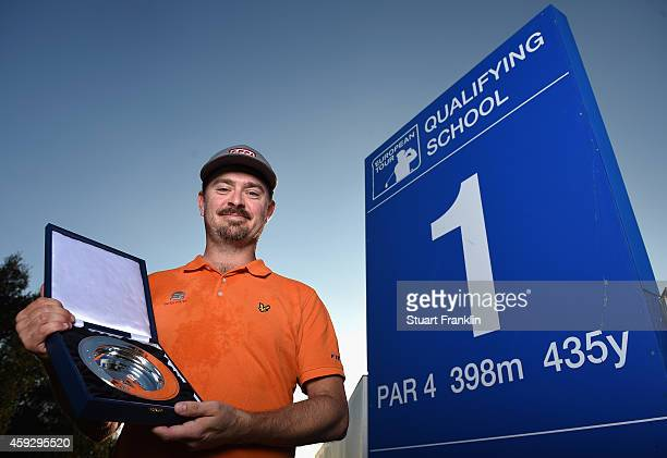 Mikko Korhonen of Finland holds the winners trophy after winning The European Tour qualifying school final stage at PGA Catalunya Resort on November...