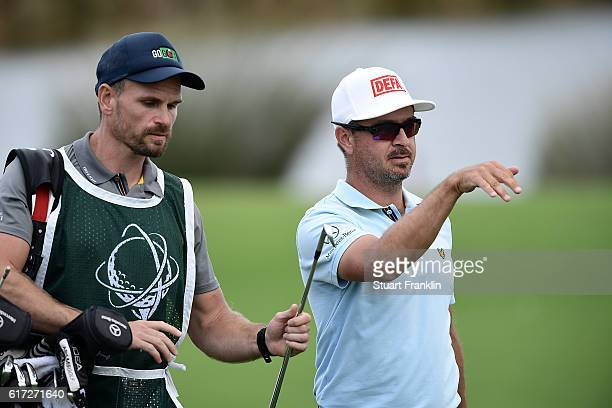 Mikko Korhonen of Finland looks on with his caddie during day three of the Portugal Masters at Victoria Clube de Golfe on October 22 2016 in...
