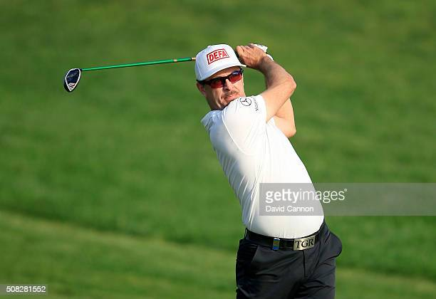Mikko Korhonen of Finland plays his second shot on the par 5 10th hole during the first round of the 2016 Omega Dubai Desert Classic on the Majlis...
