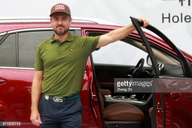 Mikko Korhonen of Finland receive his holeinone prize at Tee 16 during the second round of the Shenzhen International at Genzon Golf Club on April 22...
