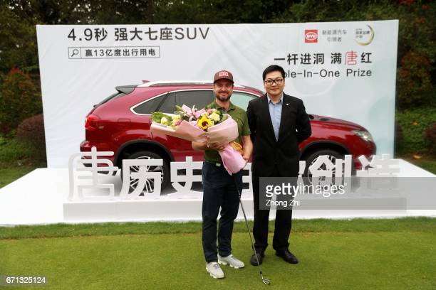 Mikko Korhonen of Finland receives his holeinone prize at Tee 16 during the second round of the Shenzhen International at Genzon Golf Club on April...