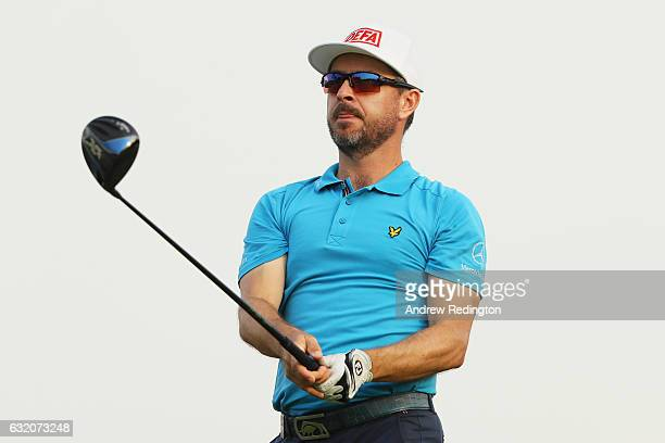 Mikko Korhonen of Finland watches his tee shot on the 16th hole during the first round of the Abu Dhabi HSBC Championship at the Abu Dhabi Golf Club...