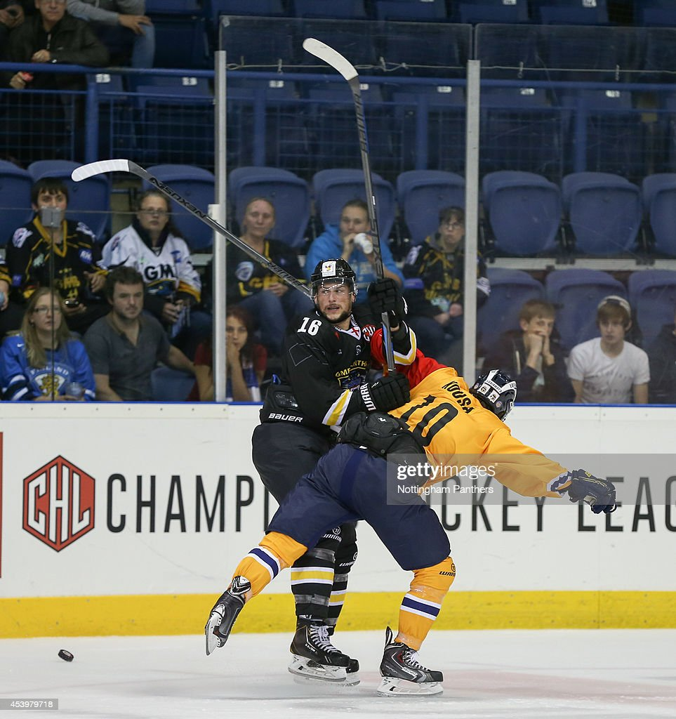 Mikko Kousa #10 of Lukko Rauma checks Max Parent #16 of Nottingham Panthers during the Champions Hockey League group stage game at the National Ice Centre in Nottingham, between Nottingham Panthers and Lukko Rauma on August 22, 2014 in Nottingham, United Kingdom.
