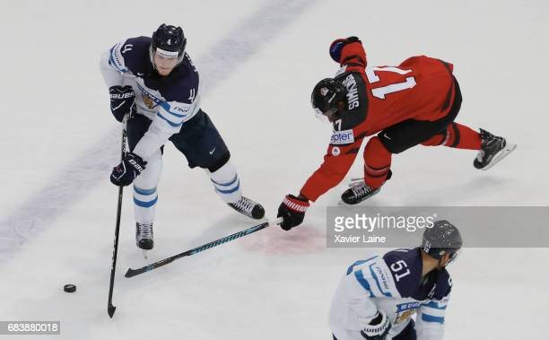 Mikko Lehtonen of Finland in action with Wayne Simmonds of Canada during the 2017 IIHF Ice Hockey World Championship game between Canada and Finland...