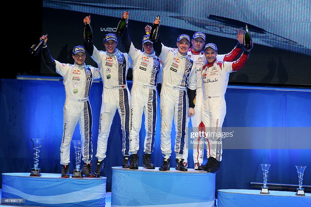 Mikko Markkula of Finland and Andreas Mikkelsen of Norway; Mikka Anttila of Finland and Jari Matti Latvala of Finland; Jonas Andersson of Sweden and Mads Ostberg of Norway are celebrating the final podium during Day Three of the WRC Sweden on February 8, 2014 in Karlstad, Sweden.