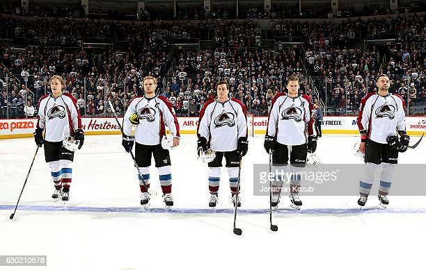 Mikko Rantanen Gabriel Landeskog Tyson Barrie Nathan MacKinnon and Fedor Tyutin of the Colorado Avalanche stand on the ice during the singing of the...