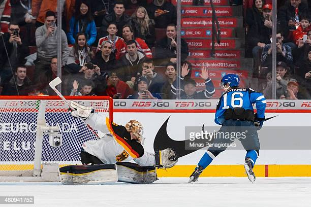 Mikko Rantanen of Team Finland is stopped by Kevin Reich of Team Germany on a penalty shot in a preliminary round game during the 2015 IIHF World...
