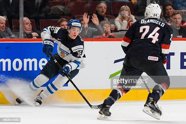 Mikko Rantanen of Team Finland stops with the puck in front of Anthony DeAngelo of Team United States during the 2015 IIHF World Junior Hockey...