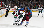 Mikko Rantanen of the Colorado Avalanche battles for position against Chris Porter of the Minnesota Wild at the Pepsi Center on October 8 2015 in...