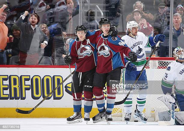 Mikko Rantanen of the Colorado Avalanche celebrates a goal against the Vancouver Canucks with teammate Nathan MacKinnon at the Pepsi Center on...