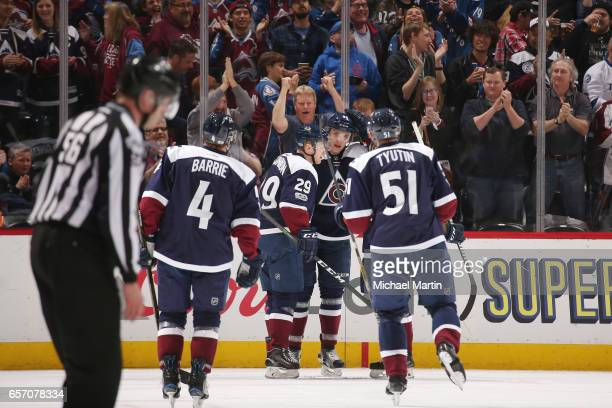 Mikko Rantanen of the Colorado Avalanche celebrates with teammates Tyson Barrie Fedor Tyutin and Nathan MacKinnon after scoring a goal against the...