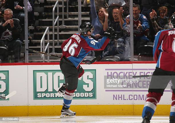 Mikko Rantanen of the Colorado Avalanche celebrates with the crowd after scoring his first career NHL goal in the game against the Winnipeg Jets at...