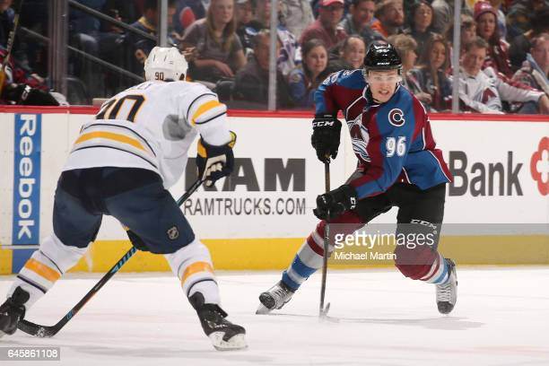 Mikko Rantanen of the Colorado Avalanche skates against Ryan O'Reilly of the Buffalo Sabres at the Pepsi Center on February 25 2017 in Denver...