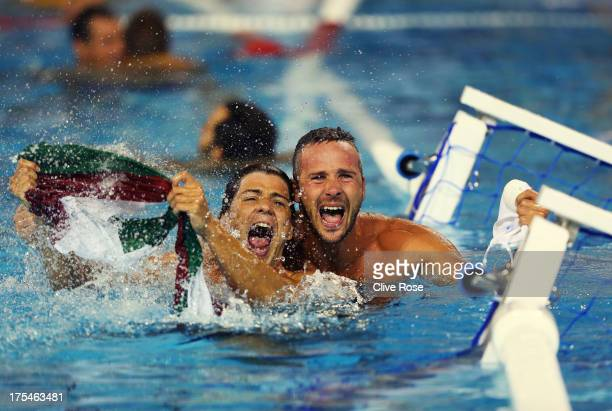 Miklos GorNagy and Marton Szivos of Hungary celebrate after victory in the Water Polo Men's Gold Medal Match between Hungary and Montenegro on day...