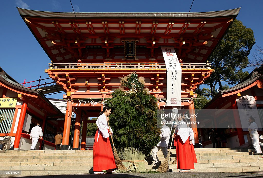 Miko (shrine maidens) clean shrine entrance after the celebration of the forthcoming 'Year of the Snake' at Ikuta Shrine on December 27, 2012 in Kobe, Japan. Japanese years are commonly associated with the twelve animals Mouse, Cow, Tiger, Rabbit, Dragon, Snake, Horse, Sheep, Monkey, Rooster, Dog and Pig.