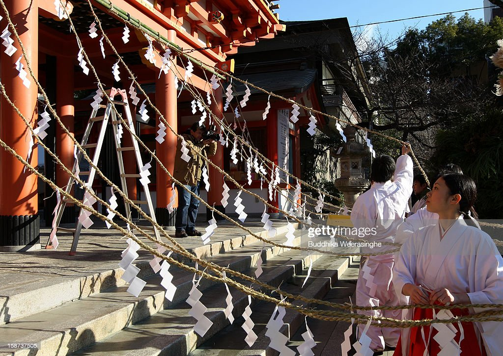 A Miko (shrine maidens) decorates shrine paper decoration for celebration of the forthcoming 'Year of the Snake' at Ikuta Shrine on December 27, 2012 in Kobe, Japan. Japanese years are commonly associated with the twelve animals Mouse, Cow, Tiger, Rabbit, Dragon, Snake, Horse, Sheep, Monkey, Rooster, Dog and Pig.