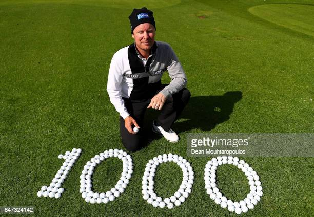 Miko Ilonen of Finland poses for a picture after hitting the 1000th European Tour hole in one on the 14th hole during day two of the KLM Open at The...