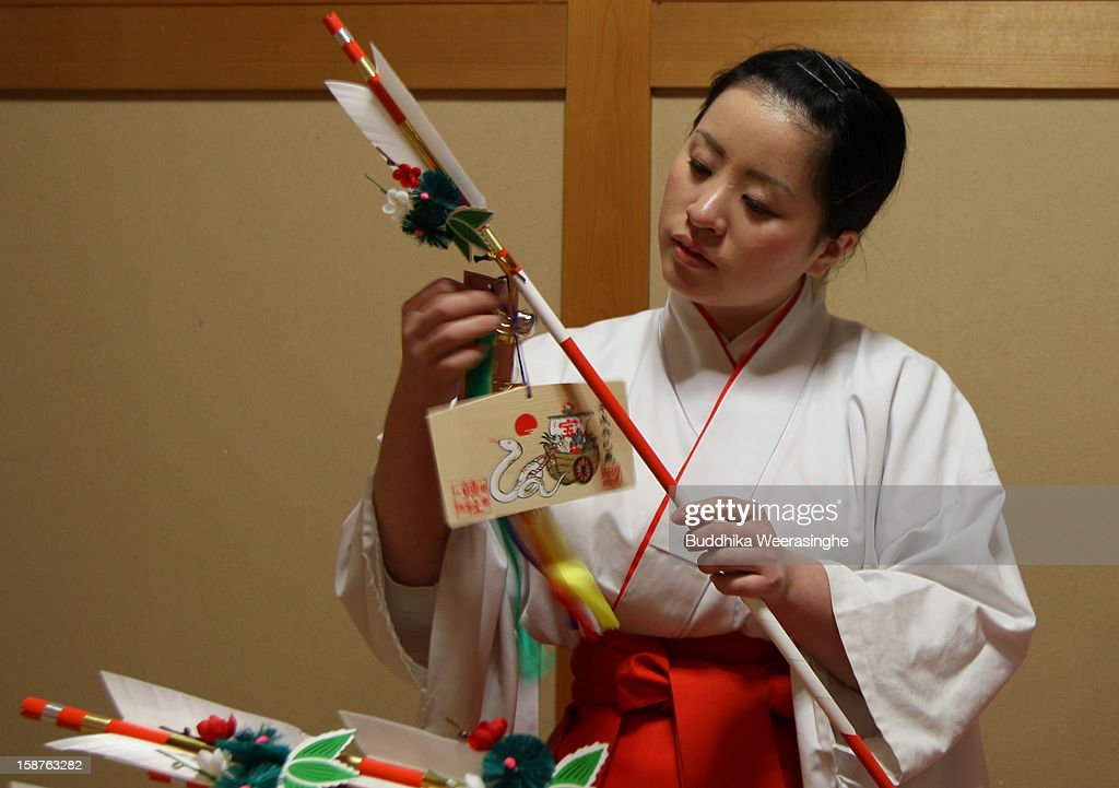 Mikos (shrine maidens) arranges 'Hamaya' (arrows intended to destroy evil spirits) to which 'Emas' (wooden plaques) are attached featuring a picture of dragon in celebration of the forthcoming 'Year of the Snake' at Sosha Shrine on December 28, 2012 in Himeji, Japan. Japanese zodiac years are organised into a twelve-year cycle of animals and are arranged in order of Rat, Ox, Tiger, Rabbit, Dragon, Snake, Horse, Sheep, Monkey, Rooster, Dog and Boar, with the belief that people born during a particular year inherit some of the characteristics or personality of that animal. Japan celebrates their New Year on January 1 of each year, following the Gregorian calendar and this coming year will be the year of the Snake.