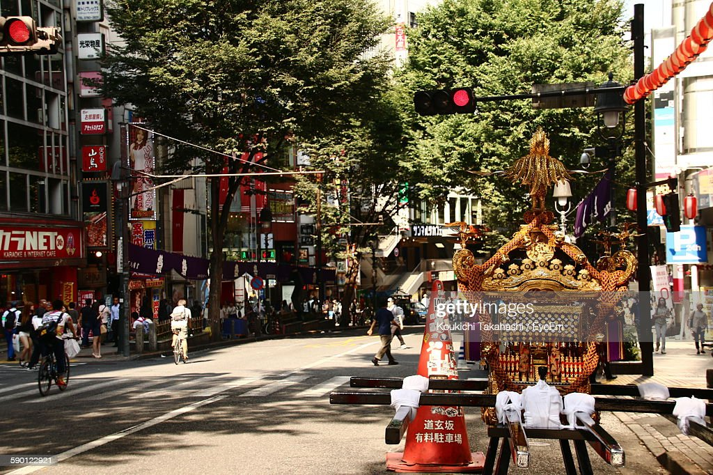 Mikoshi On City Street Against Trees